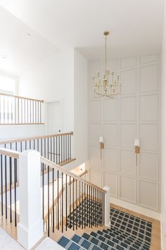 Staircase landing wall features light gray trim and brass sconces illuminating t. Staircase landing wall features light gray trim and brass sconces illuminating the stairs. Staircase Wall Decor, Staircase Landing, White Staircase, Staircase Remodel, Staircase Design, Staircase Walls, Stairwell Wall, Stairs Feature Wall, Staircase In Living Room