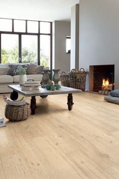 Love these honey toned floors! Lineage Oak Planks from Quick-Step's Envique Collection.
