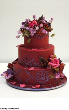 Rich, beautiful reds and pinks with stunning sugar flowers, thanks to Ron Ben Israel Cakes.