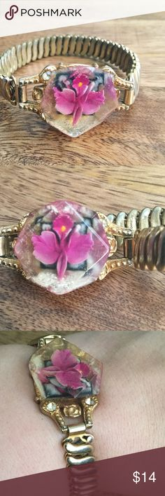 1940s Preserved Flower Bracelet Gorgeous bracelet with preserved flower encased in acrylic. Gold band stretches to fit most wrist sizes. 1940's Jewelry Bracelets