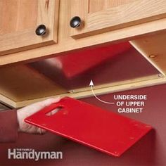 From The Family Handyman, a clever kitchen storage/organizing idea: attach a sheet of metal to the underside of an upper cabinet, and then glue some magnets to a cutting board. Stick that thing up there and you'll always have one within reach.