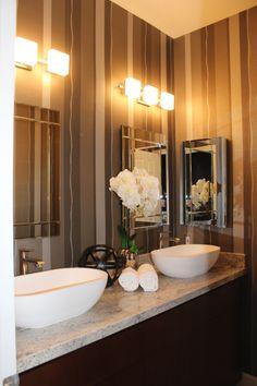 Modern bath with custom vanity, vessel sinks, beautiful frameless double mirrrors, modern sconces and bold wallpaper. #ranchointeriordesign