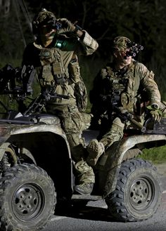 fnhfal:    Law enforcement agents ride an all-terrain vehicle during a search for escaped prisoners south of Malone, New York.