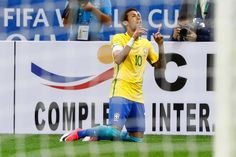 Neymar Photos Photos - Neymar of Brazil celebrates a scored goal against Paraguay during a match between Brazil and Paraguay as part of 2018 FIFA World Cup Russia Qualifier at Arena Corinthians on March 28, 2017 in Sao Paulo, Brazil. - Brazil v Paraguay - 2018 FIFA World Cup Russia Qualifier