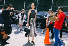 #NYFW Inspo Vogue.com's resident photographer Phil Oh is where the off-catwalk action is at New York Fashion Week. Don't miss his daily roundups of the best street style.