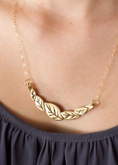 This falling leaf necklace is the perfect accessory for fall!