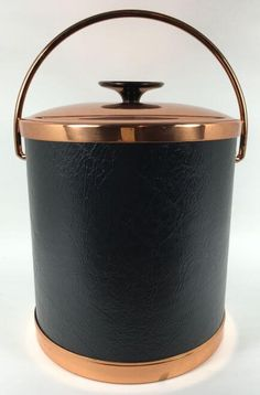 Add this to a side console table for a home bar.  Vintage Ice Bucket | Black Leather and Copper - Vintage barware and kitchenware at shopvintagegrace.com