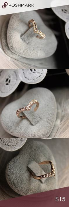 Dainty Chevron Style Crystal Ring Gold tone chevron style ring with clear crystals in the center.  NWOT Jewelry Rings