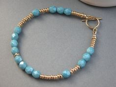 Gold bead and blue crystal bracelet. $87.80, via Etsy.