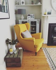 Again, can I add in yellow? Love this chair. Needs ottoman. Love the placement and table/cabinet behind chair. Love the shelf hung above cabinet. And love the wood crate by chair!