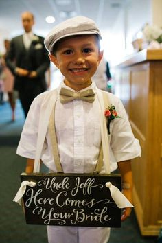 and the other side of The Ring Bearer's hand painted sign says, 'Mr. & Mrs. Zimmerman' for the Recessional - Jess & Jeff's Best Day Ever! | Backyard Soiree Weddings and Events