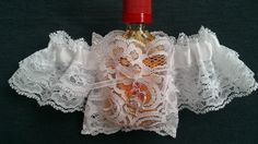 Garter with lace flask pocket for mini bottles. Fits most airline size bottles. Can also be used to hold tissues, lipstick, money, sm. juice pouch... Perfect gift for your bridesmaids and the Bride, Bachelorette party, Halloween costume, theme parties, concerts...  Each garter is made especially for you with your choice of colors. Color selection will be applied to the satin ribbon. Many shades of colors are available. If you order blue for example, do you want baby blue, royal blue, navy…