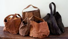by Kyoko Tomizawa featuring a range of bags dyed with persimmon juice. Textiles, Linen Bag, Black Leather Bags, Fabric Bags, Little Bag, Cloth Bags, Purses And Handbags, Fashion Bags, Shopping Bag