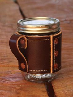 The Holdster Rivet improves upon on the best drinking vessel available: the canning jar.  Cheap, indestructible, heat-resistant, flavor neutral, healthy, and aesthetically sexy, mason jars are an icon of American made products.