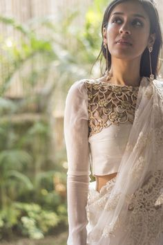 Wear this pristine white number and walk in a dream! A white raw silk body with a beige yoke filled with tiny french knots and pearls and floaty long sheer chiffon sleeves complete this blouse. A white saree to walk in that dream. Any pastel saree to keep working that magic. And finally any saree with white detailing to yet win the day. Whatsapp +91 81050 68601. *Shipping worldwide* #saree #blouse #sareeblouse #blousedesigns #desi #indianfashion #india #bollywood #white