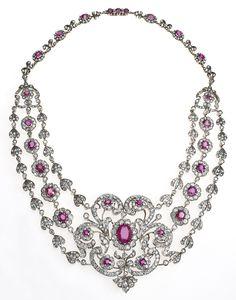 Diamond and ruby bib necklace,   circa 1880.