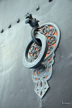 Ancient and modern door handles and knockers.