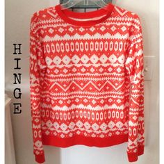 HOST PICK  Orange and White Aztec Light Sweater Pretty long sleeve top. Worn couple times. Beautiful condition. Kind of like a light weight sweater. Orange banding around hem, neck and wrists.  polyester/cotton hinge Sweaters Crew & Scoop Necks
