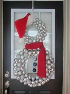 i love this but 3 wreaths instead of only 2  -  Snowman wreath!