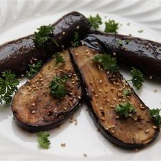 "Airfried Eggplant  Cut eggplant lengthwise into around 1/4"" thick slices. In a small bowl whisk together olive oil, balsamic vinegar, minced garlic, dried mixed herbs, salt & pepper. Brush the sauce on to the slices. 18-20 min at 200 degree, give a turn in midway.  Photo: Facebook I Love Philips Airfryer Page"