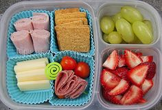 """DIY Lunchable today!  There is some ham, Wheat Thin crackers, salami and grape tomatoes, some cheddar cheese, strawberries and green grapes."""