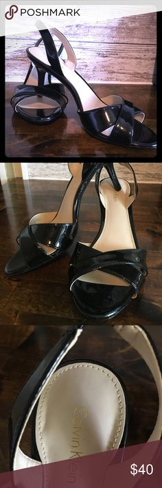 Size 7 Calvin Klein high heels Only worn a few times because my foot is too narrow. Great condition!!Black, sling back, 2 inch heals! Calvin Klein Shoes Heels