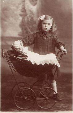 MY DOLLY & ME~Little girl with pram by Glass_Eyes, via Flickr