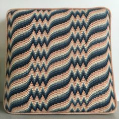 Here is a vintage handmade bargello needlepoint pillow/cushion with a repeating pink and blue ombre motif. The back and cording are pink velvet and there is no zipper. This pillow measures approximately 14 inches by 14 inches square and is 3 inches thick at the center. It is in very good vintage condition with no noted stains or rips. A wonderful addition to your vintage eclectic decor.