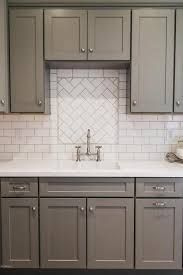 White And Gray Kitchen Features Shaker Cabinets Paired With Quartz Countertops A Subway Tiled Backsplash Like The