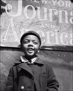 1943 Harlem Newsboy.  Photography: Gordon Parks.