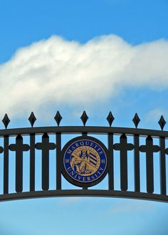 A beautiful March day at Marquette University, viewed through the archway of the Alumni Memorial Union.
