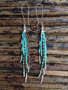 He encontrado este interesante anuncio de Etsy en https://www.etsy.com/es/listing/175429393/long-fringe-earrings-beaded-earrings