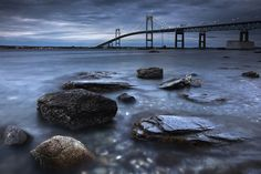 """Jamestown Rocks"" with Newport Bridge in the background, Jamestown, Rhode Island, USA. Photo by Phillip Eaglesfield."