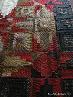 Eye candy.  The different quilting motifs and designs show the talent, creativity and skill of this quilter.