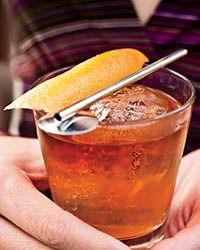 Recipe: Old-Fashioned. INGREDIENTS: 1 sugar cube, 3 dashes Angostura bitters, 1 tablespoon club soda, 2 ounces bourbon, 1 thin strip of lemon peel. In a rocks glass, combine the sugar cube, bitters and club soda. Muddle to a paste. Stir in the bourbon. Add ice and garnish with a two-inch strip of lemon peel. (Find more recipes in our Classic Cocktails Recipes slideshow. Find more recipes in our Invent Your Own Cocktail Party Recipes slideshow. From Invent Your Own Cocktail Party; Published Fe...