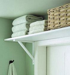 Build a shelf above the door for extra storage