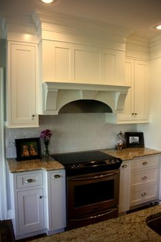 Inset, recessed panel door, I love this simple hood. Pretty arch, simple corbels, center keystone, depth on mantel shelf is nice. I love the crown detail!!!