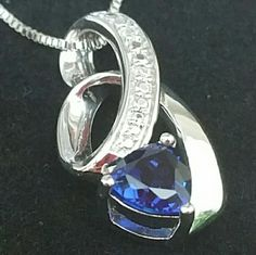 "Kay Jewelers Lab-created Sapphires Pendant Authentic Kay Jewelers Lab-created Sapphires Sterling Silver 18"" box chain with lobster clasp Stock Number 900221300 Brand new and unused will come with Kay Jewelers necklace and gift box  A ribbon of sterling silver decorated with round lab-created white sapphires unfurls around a triangle-shaped, lab-created blue sapphire in this beautiful necklace.  NOTE: Tag was removed by Kay Jewelers associate Kay Jewelers Jewelry Necklaces"