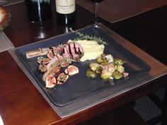 Lamb Chops with Fresh Herbs and Roasted Figs drizzled with balsamic reduction (can buy bottled glaze at store instead)