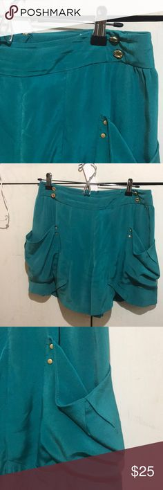 """Leifsdottir silk shorts Sz 4 I love these casual but dressy shorts, but my closet is in major need of a cleaning. Relaxed fit. Fully lined. Color is a deep turquoise. GUC — no issues I can see.   Measurements (taken flat)  14.5"""" long 15"""" waist   Unless otherwise noted, items I'm selling have been worn and will show signs of typical wear. I will note any issues in descriptions; please read those and review photos before purchasing. All items ship promptly from my non-smoking, clean…"""