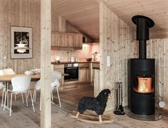 Living and dining room Cabin Homes, Cottage Homes, Swedish Cottage, Barn House Plans, Cabin Interiors, Cabins And Cottages, Fireplace Design, Cabins In The Woods, Home Staging