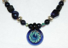 """This is a gorgeous hand-blown glass implosion pendant. It is about 1 1/2"""" in diameter."""