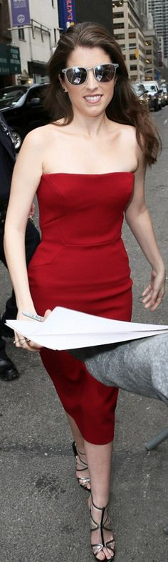 Who made Anna Kendrick's silver sandals and red strapless dress?