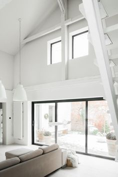 White walls and stairs in minimalist space