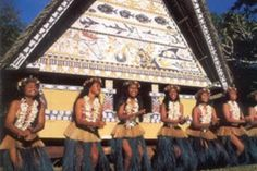 Palau traditional female dancers in front of a Abai -traditional meeting house for chiefs