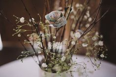 paper flowers, twigs and babies breath
