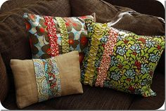 three ruffle pillows