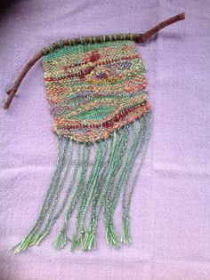 Here are the weavings I've been doing on my Pocket Loom  I have been calling them Spirit Weavings.             These three have twig hangers...