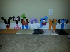 Our masterpiece! Paper mache letters from a craft store, painted like Mickey Mouse Clubhouse characters.