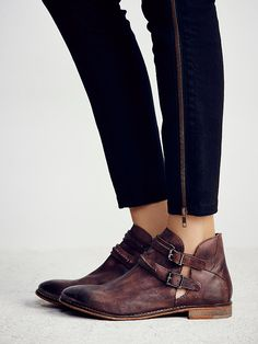 Braebrun Ankle Boot | Rugged leather ankle boots with cool open sides. Double ankle straps; adjustable, with brass buckles.  *By Free People